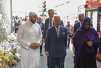 The Prince of Wales visits flowers tribute and has a walkabout in Finsbury Park flanked by the Iman Mohammed Mahmoud of the Muslim Welfare House and local student Sahra Mohamed. London, England June 21, 2017<br /> CAP/CAM<br /> &copy;Andre Camara/Capital Pictures /MediaPunch ***NORTH AND SOUTH AMERICAS ONLY***