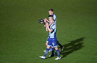 Michael Harriman of Wycombe Wanderers leaves the field with teammates after  the Sky Bet League 2 match between Wycombe Wanderers and Plymouth Argyle at Adams Park, High Wycombe, England on 14 March 2017. Photo by Andy Rowland / PRiME Media Images.