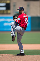 Tacoma Rainiers relief pitcher Lindsey Caughel (13) prepares to deliver a pitch during a Pacific Coast League against the Sacramento RiverCats at Raley Field on May 15, 2018 in Sacramento, California. Tacoma defeated Sacramento 8-5. (Zachary Lucy/Four Seam Images)