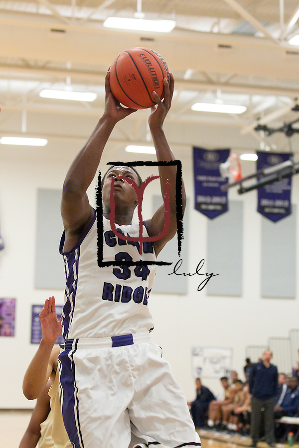 Cedar Ridge's Tim Holland attempts a basket against Akins Tuesday evening at home.  The Raiders beat the Eagles 60-58.  (LOURDES M SHOAF for Round Rock Leader.)