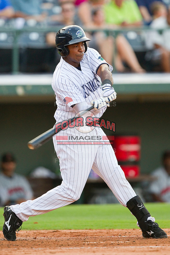 Gookie Dawkins #9 of the Charlotte Knights takes his swings against the Indianapolis Indians at Knights Stadium on July 26, 2011 in Fort Mill, South Carolina.  The Knights defeated the Indians 5-4.   (Brian Westerholt / Four Seam Images)