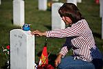 ARLINGTON, VA - NOVEMBER 11: Maria Rodriquez visits the grave of her son Ronald Rodriguez on Veteran's Day at Arlington National Cemetery on November 11, 2012 in Arlington, Virginia.