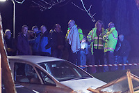 Pictured: Locals gather in the Waunceirch area of Neath, Wales, UK. Monday 14 January 2018<br /> Re: Four flats have been evacuated after an explosion in Neath at 8:30pm on Monday.<br /> Extensive damage was caused to Waun Las, in the Waunceirch area and arrangements made to house its residents until the building is deemed safe.<br /> One woman was taken to hospital with serious burn injuries which are not believed to be life threatening.<br /> A joint investigation is under way between South Wales Police and the fire service to determine the cause.<br /> Wales and West Utilities said the gas supply to the affected property had been isolated.
