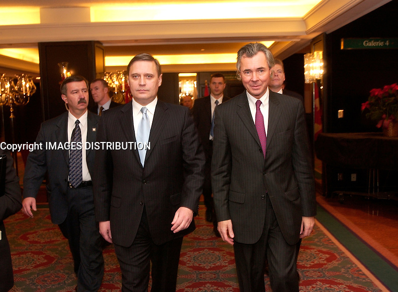 Tuesday December 11, 2001, Prime Minister<br /> MIKHAIL KASYANOV of the Russian Federation (L)  walk with Canadian Minster of Foreign Affairs and International trade ; Pierre Pettigrews (R) after attending a<br /> Round Table with Canadian business leaders hosted by SNC-Lavalin, and beeing <br /> witness to the signing of a Memorandum for Strategic Cooperation between SNC-<br /> Lavalin Inc. and OAO Russkiy Aluminy Group (Rusal). SNC-Lavalin's <br /> <br /> Photo by Sevy-Images Distribution<br /> <br /> NOTE : uncorrected D-1H  Jpeg,., saved as Adobe 1998 RGB