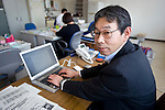 ToshiyaFujiwara, manager of the Operations Planning Office at the Ishinomaki branch of Japan Post Service Co., Ltd. sits at his desk in Ishinomaki, Miyagi Prefecture, Japan on Tuesday 24 May 2011..Prior to the March 11 quake and tsunamis, the office delivered around 95,000 items of post to some 85,000 households daily and was the headquarters for 15delivery centresin surrounding towns and villages. .Photographer: Robert Gilhooly
