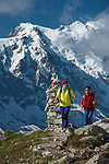Trekking in the Aiguilles Rouges National Nature Reserve, at background can be seen the Mont Blanc , Mont Blanc Massif, French Alps, Chamonix, France