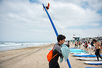 Incoming Occidental College students participate in Oxy Engage, in which they can explore the Los Angeles area before orientation. This group learned to surf at Manhattan Beach, Aug. 20, 2015.<br />