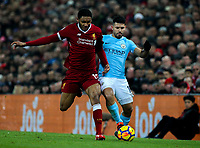 Manchester City's Sergio Aguero is dispossessed by Liverpool's Joe Gomez<br /> <br /> Photographer Alex Dodd/CameraSport<br /> <br /> The Premier League - Liverpool v Manchester City - Sunday 14th January 2018 - Anfield - Liverpool<br /> <br /> World Copyright &copy; 2018 CameraSport. All rights reserved. 43 Linden Ave. Countesthorpe. Leicester. England. LE8 5PG - Tel: +44 (0) 116 277 4147 - admin@camerasport.com - www.camerasport.com
