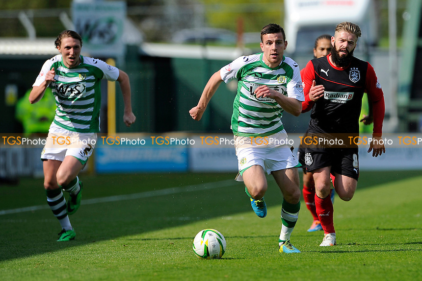 Rubén Palazuelos of Yeovil Town pushes forward chased by Adam Clayton of Huddersfield Town - Yeovil Town vs Huddersfield Town - Sky Bet Championship Football at Huish Park, Yeovil, Somerset - 21/04/14 - MANDATORY CREDIT: Denis Murphy/TGSPHOTO - Self billing applies where appropriate - 0845 094 6026 - contact@tgsphoto.co.uk - NO UNPAID USE