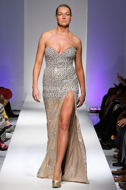 Model walks runway in an evening dress from the Jovani Couture collection by Julie DuRocher, during BK Fashion Weekend Spring Summer 2013, September 28, 2012.