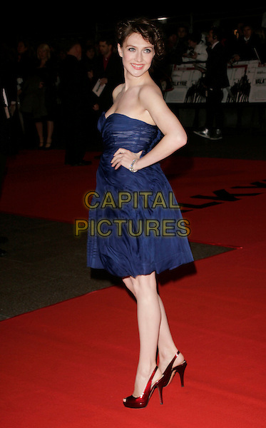 "CARICE VAN HOUTEN.At the UK Film Premiere of ""Valkyrie"", Odeon Leicester Square, London, England, January 21st 2009..full length strapless ink blue chiffon dress hands on hips red burgundy patent shoes peep toe open.CAP/AH.©Adam Houghton/Capital Pictures"