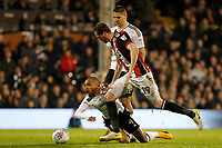 Denis Odoi of Fulham FC is felled by Richard Stearman of Sheffield United during the Sky Bet Championship match between Fulham and Sheff United at Craven Cottage, London, England on 6 March 2018. Photo by Carlton Myrie.