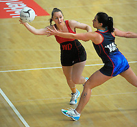 Action from the 2015 National Netball Championship match between Auckland (blue) and Christchurch (red and black) at ASB Sports Centre, Kilbirnie, Wellington, New Zealand on Tuesday, 29 September 2015. Photo: Dave Lintott / lintottphoto.co.nz