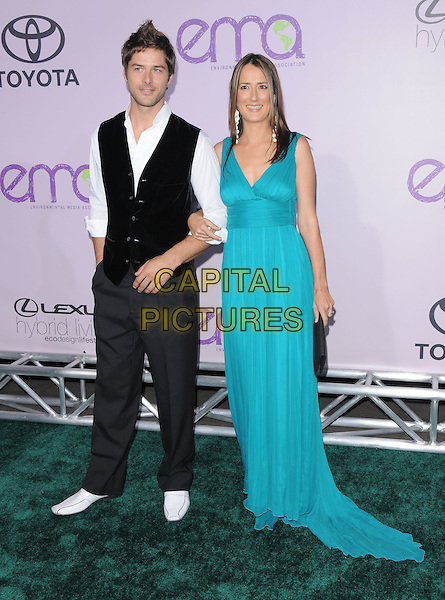 GUEST & ANNA GETTY.The 18th Annual Environmental Media Awards held at The Ebell Theatre in Los Angeles, California, USA..November 13th, 2008.full length black waistcoat blue turquoise long maxi dress arms linked.CAP/DVS.©Debbie VanStory/Capital Pictures.
