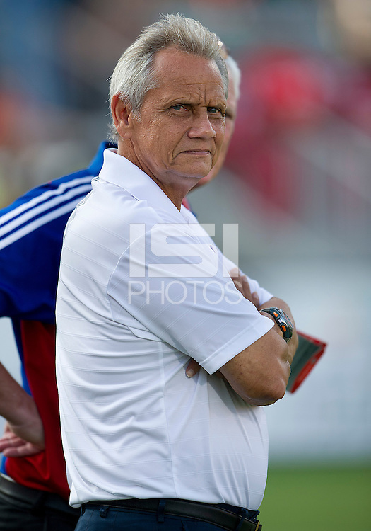 FC Dallas head coach Schellas Hyndman watches his team take warm-ups during an MLS game between the FC Dallas and the Toronto FC at BMO Field in Toronto on July 20, 2011..FC Dallas won 1-0.