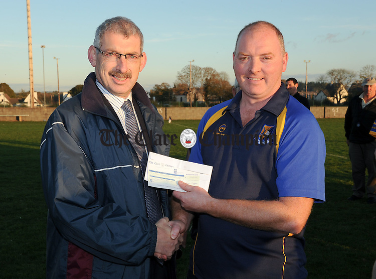Liam Duggan of The Clare Champion presents a cheque for EUR4000 to Sixmilebridge manager Christy Chaplin after the Clare Champion Cup final at Clarecastle. Photograph by John Kelly..