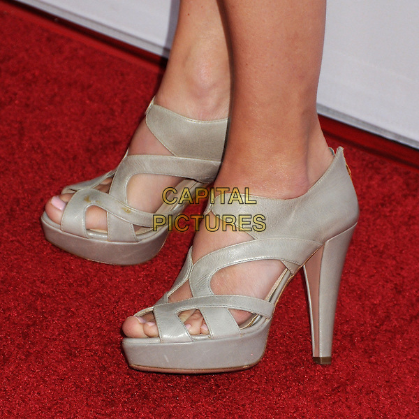 Calista Flockhart's shoes <br /> &quot;Paranoia&quot; Los Angeles Premiere held at the Directors Guild of America, West Hollywood, California, USA, 8th August 2013.<br /> detail feet platform greige cut out open toe  silver grey gray<br /> CAP/ADM/BP<br /> &copy;Byron Purvis/AdMedia/Capital Pictures