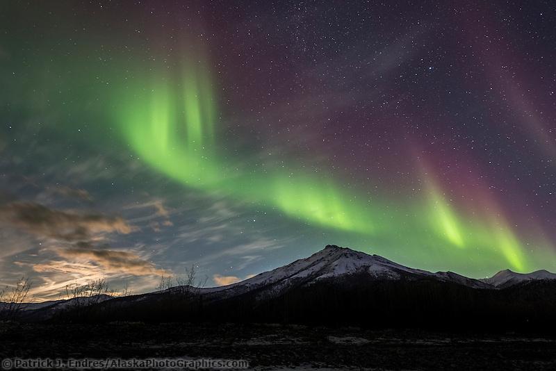 Colorful aurora over Alaska's Brooks Range mountains.