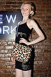 Model poses with a MaryLai handbag during the inaugural Wear New York Fashion Week presentation at 393 Broadway on June 27, 2013.