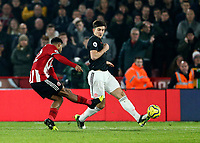 24th November 2019; Bramall Lane, Sheffield, Yorkshire, England; English Premier League Football, Sheffield United versus Manchester United; Lys Mousset of Sheffield United shoots past Harry Maguire of Manchester United challenge and scores in the 52nd minute to make it 2-0 - Strictly Editorial Use Only. No use with unauthorized audio, video, data, fixture lists, club/league logos or 'live' services. Online in-match use limited to 120 images, no video emulation. No use in betting, games or single club/league/player publications