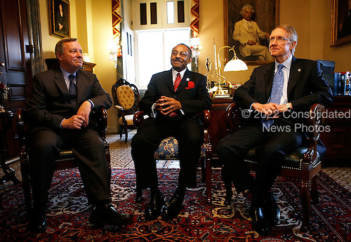 Washington, DC - January 7, 2009 -- Illinois U.S. Senate appointee Roland Burris (C) meets with Senate Majority Leader Harry Reid (Democrat of Nevada) (R) and Senate Majority Whip Richard Durbin (Democrat of Illinois) (L) on Capitol Hill Tuesday,January 7, 2009 in Washington, DC. Burris, who was appointed by Illinois Governor Rod R. Blagojevich to replace President Elect Barack Obama's Senate seat, returned to the Hill for a meeting with Democratic Senate leaders to discuss his appointment to the Senate.  .Credit: Alex Wong - Pool via CNP