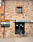 SPAIN, Ezcaray, La Rioja, street sign and bicycle by building wall