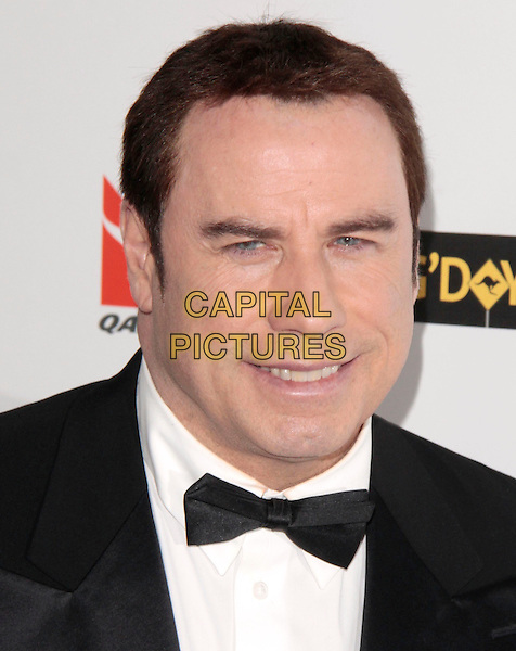 JOHN TRAVOLTA.Attending the 2010 G'Day USA Australia Week Black Tie Gala held at the Hollywood & Highland Grand Ballroom, Hollywood, California, USA, .16th January 2010. .arrivals portrait headshot bow tie black  smiling                  .CAP/RKE/DVS .©DVS/RockinExposures/Capital Pictures