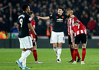 24th November 2019; Bramall Lane, Sheffield, Yorkshire, England; English Premier League Football, Sheffield United versus Manchester United; Harry Maguire of Manchester United has a chat with David McGoldrick of Sheffield United after he didnt kick the ball out of play when Lys Mousset of Sheffield United was injured - Strictly Editorial Use Only. No use with unauthorized audio, video, data, fixture lists, club/league logos or 'live' services. Online in-match use limited to 120 images, no video emulation. No use in betting, games or single club/league/player publications