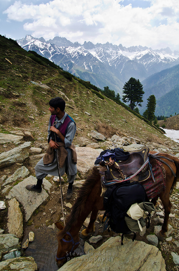 Gypsy horseman and guide in the stunning alpine wonderland above Naranag, Western Himalayan Mountains, Kashmir, India..
