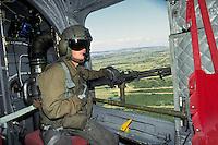 - machine-gunner on a CH 46 transport helicopter of US Marines during NATO exercises at cape Teulada (Sardinia) ....- mitragliere a bordo di un elicottero da trasporto CH 46 degli US Marines durante esercitazioni NATO a capo Teulada (Sardegna)