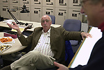Dick Kraus at a gathering of staff in the Photo dept. prior to joining others in the City room to toast the departure of colleagues on Friday March 1, 2002. (Photo by Jim Peppler).