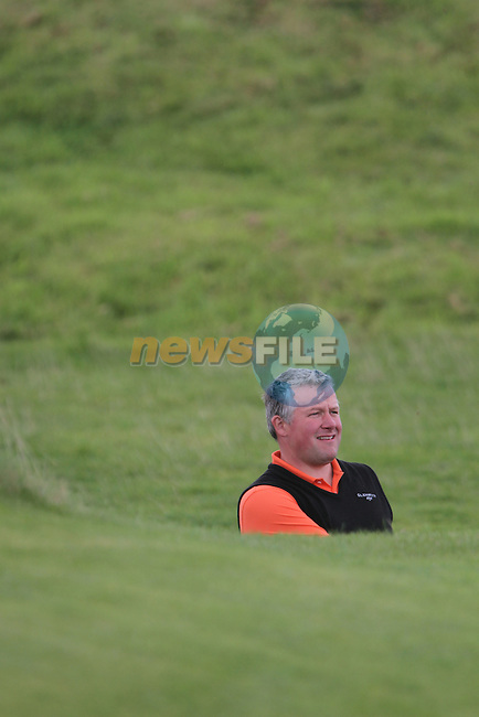 Day one of the Irish PGA championship at Seapoint Golf Club, Robert Giles from Greenore hitting onto the 9th green...Picture Jenny Matthews/Newsfile.ie