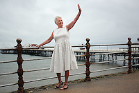 2016 05 26 'Girl in the spotty' dress Pat Stewart returns after 65 years to Blackpool, UK