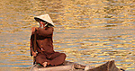 Vietnamese Boatman 01 - Vietnamese boatman in a small boat on the Thu Bon River, Hoi An, Viet Nam