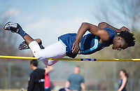 NWA Democrat-Gazette/CHARLIE KAIJO Austin Garrett, 15, of Springdale Har-Ber high jumps during the Tiger Relays track meet, Friday, March 16, 2018 at the Tiger Athletic Complex in Bentonville.