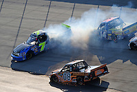 May 30, 2008; Dover, DE, USA; Nascar Craftsman Truck Series driver Andy Lally spins in traffic during the AAA Insurance 200 at Dover International Speedway. Mandatory Credit: Mark J. Rebilas-US PRESSWIRE.