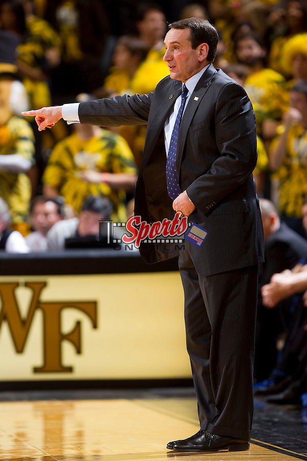 Duke Blue Devils head coach Mike Krzyzewski calls out a play during second half action against the Wake Forest Demon Deacons at the LJVM Coliseum on February 28, 2012 in Winston-Salem, North Carolina.  The Blue Devils defeated the Demon Deacons 79-71.  (Brian Westerholt / Four Seam Images via AP Images)