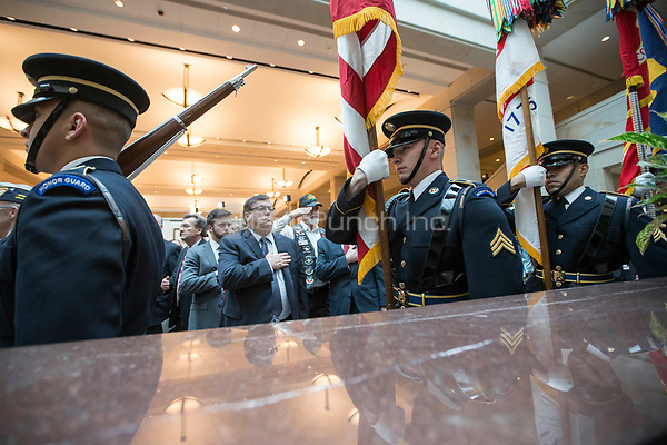 The Honor Guard enters during a ceremony dedicating a chair in the United States Capitol Building to honor United States soldiers labeled as 'Prisoners of War' or 'Missing in Action' at the United States Capitol Building in Washington, D.C. on November 8th, 2017. <br /> Credit: Alex Edelman / CNP /MediaPunch