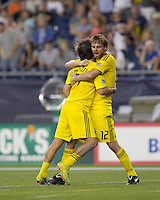 Columbus Crew forward Guillermo Barros Schelotto (7) celebrates his penalty kick goal with Columbus Crew midfielder Eddie Gaven (12). The New England Revolution tied Columbus Crew, 2-2, at Gillette Stadium on September 25, 2010.