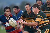 The presure is on from Amos Mataia as Blair Feeney gets the pass away. Counties Manukau Premier Club Rugby semi final game between Ardmore Marist & Pukekohe played at Bruce Pulman Park Papakura on Saturday July 19th 2008. Ardmore Marist won 18 - 15 & will meet Patumahoe in the final next weekend.