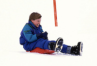 Prince William sledging, in Lech, Austria, with his brother Prince Harry, on an annual ski holiday with their mother, The Princess of Wales.