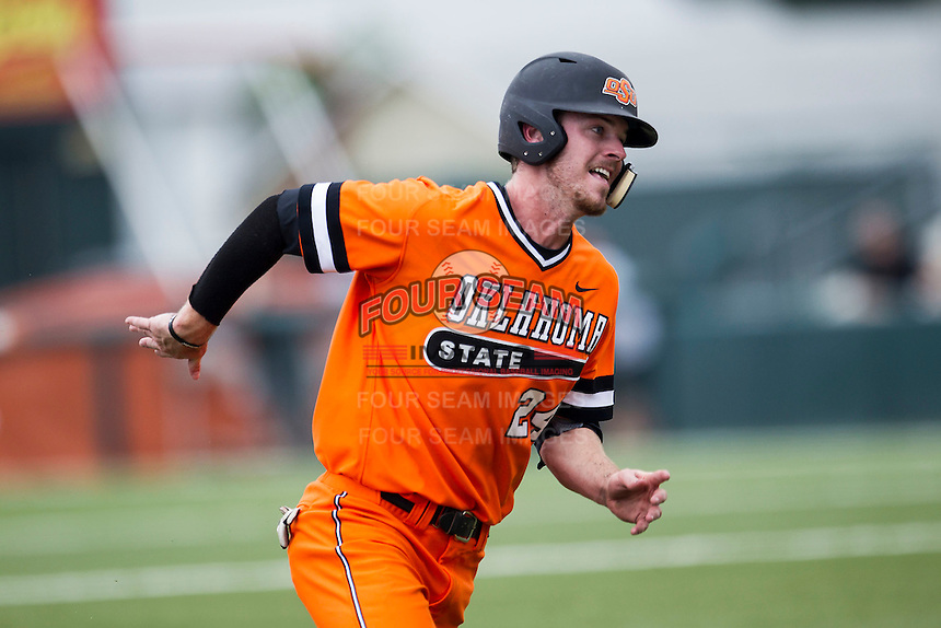 Oklahoma State Cowboys outfielder Conor Costello #24 hustles around third base during the NCAA baseball game against the Texas Longhorns on April 26, 2014 at UFCU Disch–Falk Field in Austin, Texas. The Cowboys defeated the Longhorns 2-1. (Andrew Woolley/Four Seam Images)