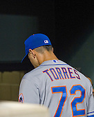 New York Mets relief pitcher Carlos Torres (72) walks to the club house after giving-up a walk-off home run to Baltimore Orioles left fielder Henry Urrutia (51) in the ninth inning at Oriole Park at Camden Yards in Baltimore, Maryland on Wednesday, August 19, 2015.  The home run gave the Orioles a 5 - 4 victory.<br /> Credit: Ron Sachs / CNP<br /> (RESTRICTION: NO New York or New Jersey Newspapers or newspapers within a 75 mile radius of New York City)