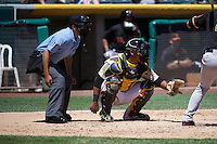 Luis Martinez (20) of the Salt Lake Bees behind the plate with home plate umpire Alex Ortiz against the Fresno Grizzlies at Smith's Ballpark on May 26, 2014 in Salt Lake City, Utah.  (Stephen Smith/Four Seam Images)