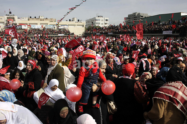 Palestinian women take part in a rally organised by the Popular Front for the Liberation of Palestine (PFLP) to celebrate the 42nd anniversary of its establishment in Gaza City on December 12, 2009. Photo by Ashraf Amra