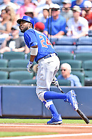 Chicago Cubs center fielder Dexter Fowler (24) runs to first during a game against the Atlanta Braves at Turner Field on June 11, 2016 in Atlanta, Georgia. The Cubs defeated the Braves 8-2. (Tony Farlow/Four Seam Images)