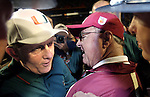 Bobby Bowden (R) and Miami's  Larry Coker talk at midfield after Miami defeated FSU 16-14 in the Orange Bowl January 1, 2004. (Mark Wallheiser/TallahasseeStock.com)