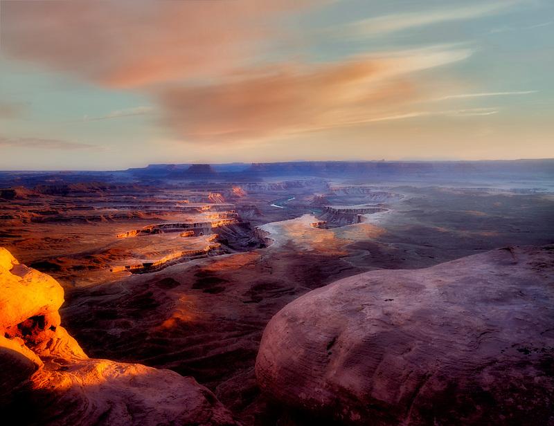 Sun peeking through storm clouds at Green River Overlook. Canyonlands National Park. Utah.