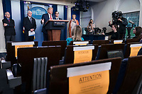 United States President Donald J. Trump delivers remarks on the COVID-19 (Coronavirus) pandemic alongside members of the Coronavirus Task Force in the Brady Press Briefing Room at the White House in Washington, DC, March 25, 2020, in Washington, D.C.   Standing behind the President, from left to right: Director of the National Institute of Allergy and Infectious Diseases at the National Institutes of Health Dr. Anthony Fauci; US Vice President Mike Pence; US Secretary of the Treasury Steven T. Mnuchin; and Dr. Deborah L. Birx, White House Coronavirus Response Coordinator.<br /> Credit: Sarah Silbiger / Pool via CNP/AdMedia