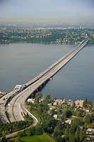 Aerial view of I-90 floating bridges spanning Lake Washington from Mercer Island to Seattle